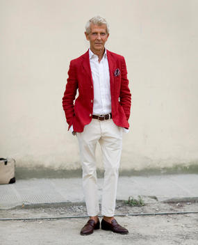 Senior Man Wearing A Bright Red Blazer, Florence, Tuscany, Italy.