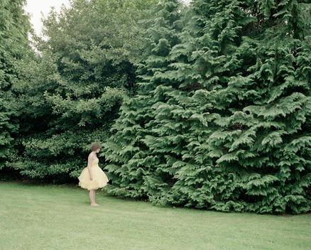 Woman With Pretty Dress Standing On Lawn