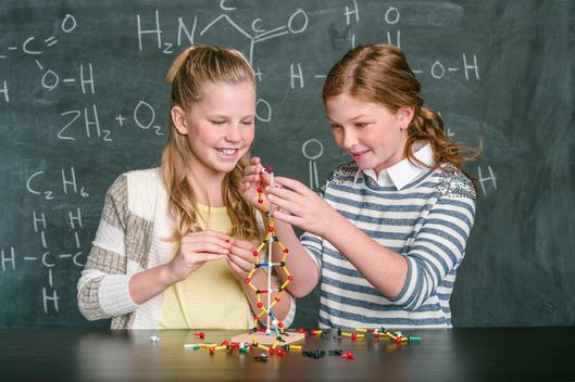 Girls (10-12) with molecular model