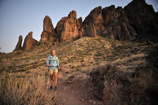 Female backpacker hiking, Apache Junction, Arizona, USA