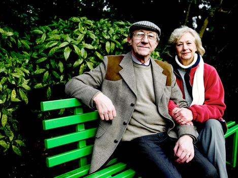 Portrait Of Senior Couple Relaxing On Park Bench