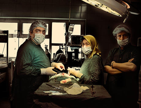 A team of surgeons opperating in a hospital in Iraq