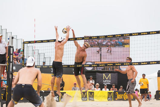 Professional Beach Volleyball Players in action