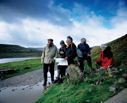 Group Of Senior Hikers Pause To Look At Map