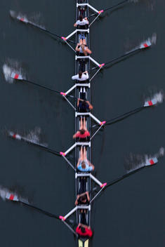 overhead view of crew team rowing on a scull on the Schuylkill River