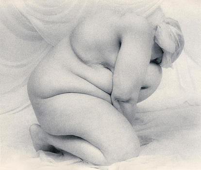 One heavy nude woman in the form of a folded and fleshy sculpture