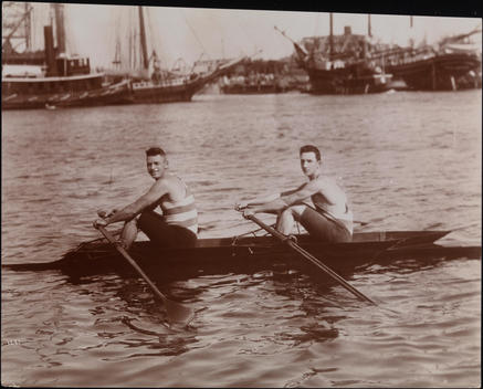 Two Athletes Posed In A Rowing Shell On The Harlem River.
