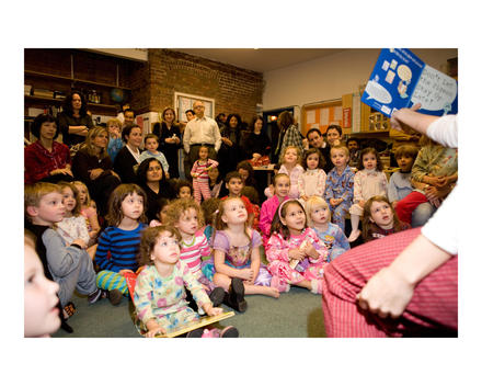 A Large Group Of Children Being Read To