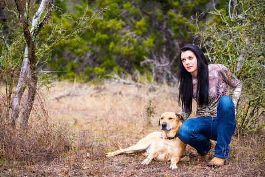 Young woman with Blackmouth dog in natural environment