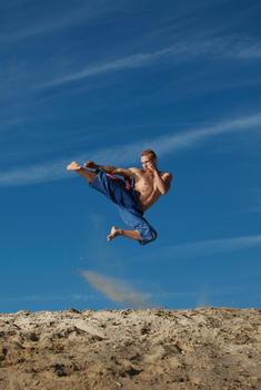 Germany, Bavaria, Young man doing martial arts training