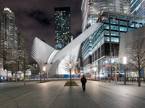 Transportation Hub in illuminated in the background designed by Santiago Calatrava. World Trade Center