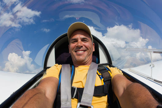 Germany, Bavaria, Bad Toelz, Mature man in glider, smiling, portrait