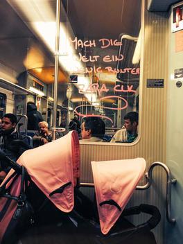 Germany, Baden-Wuerttemberg, Stuttgart, lettering and stroller in metro, public transport