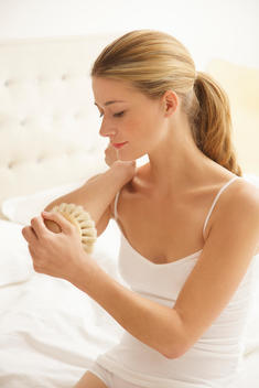Woman Exfoliating her Elbow