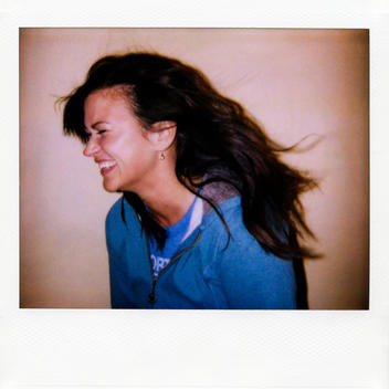 Instant Film Photograph Of Young Woman Laughing