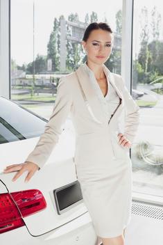 At the car dealer, Portrait of confident saleswoman