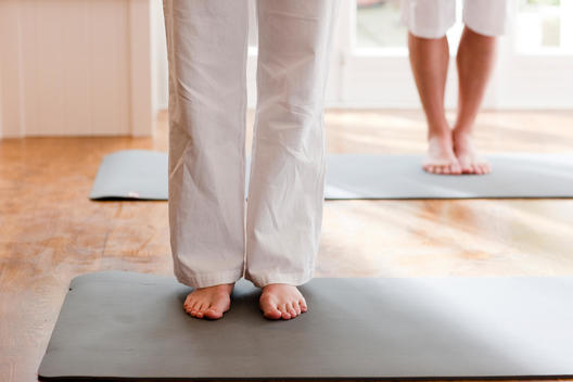 Two people legs and feet during a yoga practice