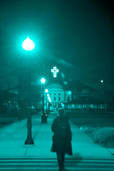 Woman Walking Towards Church At Night