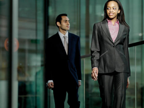 Creative Young Professionals In Business Attire Walking In Office