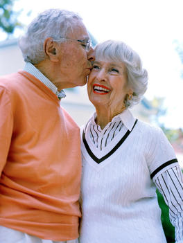 Portrait Of A Senior Couple Kissing.