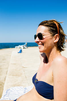 Woman sunbathing at the coast