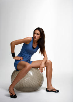 Woman Sitting On Medicine Ball
