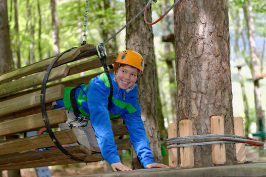 Austria, Alto Adige, Adventure Park Kaltern, Boy on high ropes course