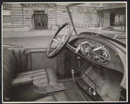 Close Up Of The Interior Of A Circa 1921 Lexington Roadster Parked On The Street In Front Of A Neo-Classical Building.