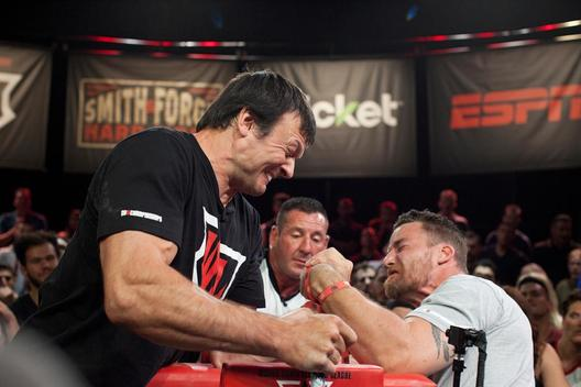 Two arm wrestling competitors at the competition in Las Vegas struggle against each other