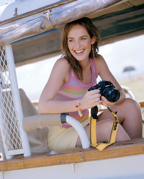 Young Woman With Camera On Safari