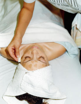 Woman Receiving A Facial Treatment At Day Spa.