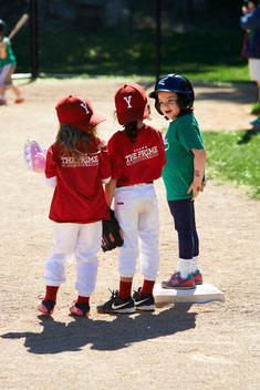 young girls at softball game near 4 the base