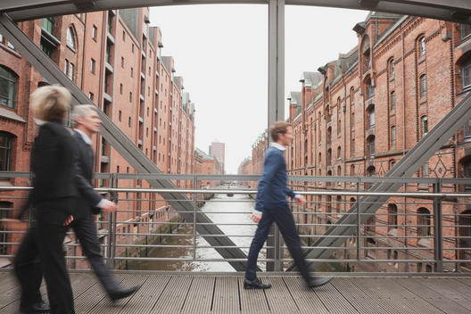 Germany, Hamburg, Business people crossing bridge