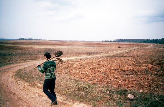 Man Going To Work In The Fields