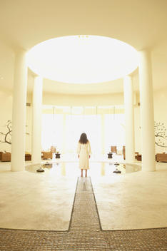 Woman in robe at health spa