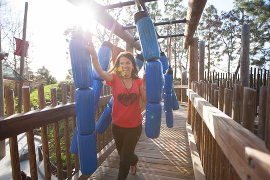 A woman playing at an amusement park.