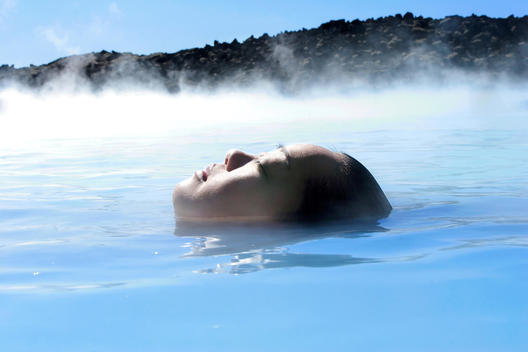Woman Relaxing In Geothermal Pool, Iceland
