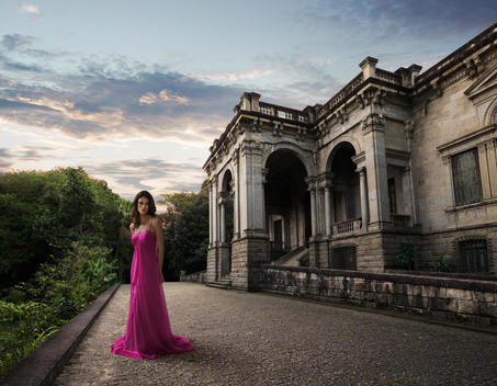 a woman in an evening dress in front of a colonial building in rio de janeiro