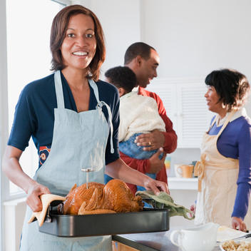 Black woman preparing Thanksgiving dinner