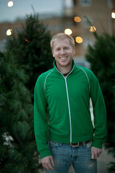 Portrait Of Young Man In Christmas Tree Lot