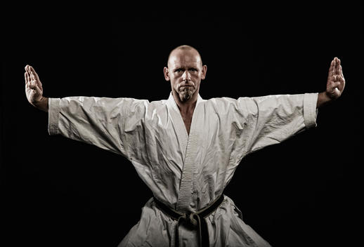 Germany, Bavaria, Mature man doing karate, portrait