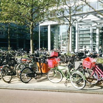 The Netherlands, Amsterdam, Bicycles in front of a modern office building,