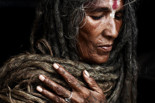 Sabrida Shing. One Of The Few Rare Women To Take On The The Task Of Becoming A Sadhu. She Has Not Cut Her Hair Since Her Husband Died, Making The Ends Of The Dreadlocks Over 10 Years Old. Kathmandu, Nepal