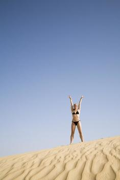 Young Athletic Lady Wearing A Bikini In The Sahara Desert