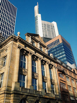 Neo-classical facade with high-rise buildings, Commerzbank Tower in the background, Frankfurt, Hesse, Germany