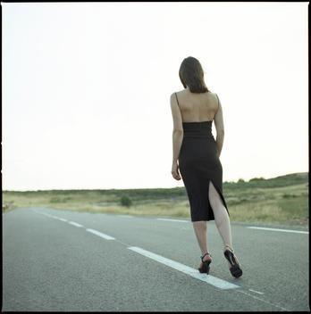 Woman In Chic Dress Walking Along Highway, Col De La Fayol, France