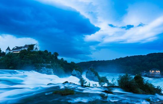 Rhine river falls with thunderstorm approaching, Schaffhausen, Switzerland