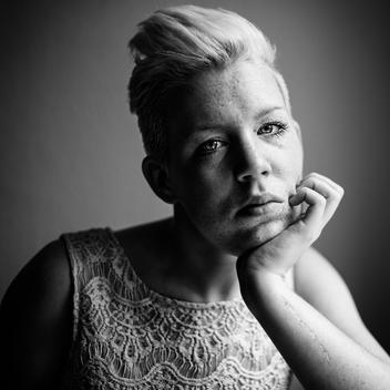 Portrait of woman with mohawk haircut and freckles, close up