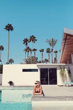 Alexis Ren relaxes poolside