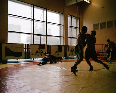 A Group Of Men Wrestling In The Far-Eastern Academy Of Physical Education.
